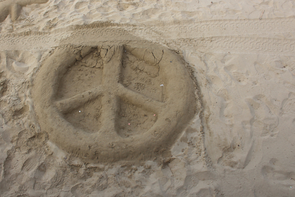peace sign sand castle